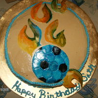 Flaming Soccer Ball   chocolate cake with peanut butter frosting.. all accents made out of mmf