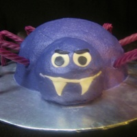 Spider   Cream cheese frosting, fondant face, grape licorice legs.