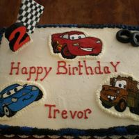 "Trevor.jpg I made this for a family friend two year old son's birthday.First time using BCT and fondant as ""props""."