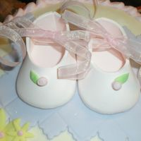 Baby Shower gumpaste booties made to resemble the invitation