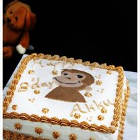 Curious George Cake My 1st trial on white chocolate transfer on whipped topping...