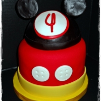 Mickey Mouse Chocolate cake with MacMom's BC Flavored Fondant with candy melts added. The Mickey hat is styrofoam covered in fondant. Goes with the...