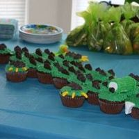 "Alligator Cupcakes Cake Alligator cupcakes, very cute and fun to make. The spikes are 100 Calorie Oreo Crackers, the teeth and eyes are marshmallows, the ""..."