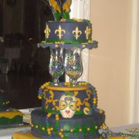 Mardi_Gras_Prom_And_Cake_025.jpg Four (8, 10, 14 in round and 16 x 16 in square) tiered cake with Hurrican glasses (prom favors) used to divide layers. All gumpaste and...