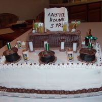 "5Th Anniversary This is the cake I made for the 5th Anniversary of the bar called ""Another Round"" which is where I work. White cake base and Whte..."