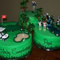 Golf Cake Cakes frosted with American buttercream, 18th hole was created using angel food cake, the waterfall was created using the ends of the angel...