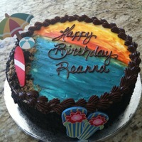 Tropical/beach Birthday Chocolate cake with chocolate mousse frosted in ganache. Sand was crushed honey graham crackers. Items on cake were purchased at local...