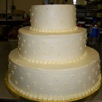 Swiss Dot Wedding Cake 3 tier wedding cake. Swiss dot decoration, frosted in buttercream