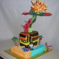 Jamaica  The bus and shell are all cake covered in fondant. The hibiscus flowers and bucket with shovel are gumpaste. The beach towel, man, snorkel...
