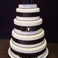 Black And White Wedding   The bride picked this cake from Wedding Cakes magazine. I think it was done by Lucky Sixpence. I hope I did it a little bit of justice.