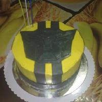 Transformers Cake A transformers cake I made for my nephew's 3rd birthday. Chocolate mud cake with BC icing and MMF accents. Meant to be Bumblebee-...