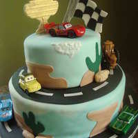 "Cars Cake! This was covered in marbled fondant to mimic the sky, and the ""mountains"" as well. Thanks to some CC members for the inspiration..."