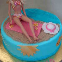 Barbie Beach Cake Butter cream covered with fondant and gum paste details. Real Barbie on top. TFL!