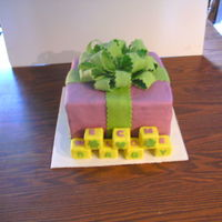 Welcome Baby Purple Green  this is a baby shower cake, 3 10inch square, covered in fondant, with RKT blocks that spell out welcome from the top, and baby from the...