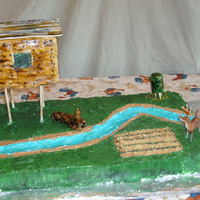 Hunting Cake  This is a very nlarge cake all buttercream, except the stream has piping gel on top. The deer stand is cake with fondant sides and a...