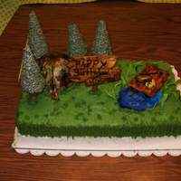 Matts Hunting/fishing Cake  This is a double layer, everything is handpainted gumpaste /fondant, except the hunting blind. It is a seperate cake, covered in fondant...