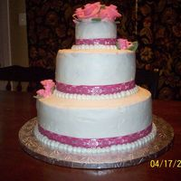First Wedding/stacked Cake This is my first stacked/wedding cake. WASC cake with buttercream. Made this for my nephew's wedding tomorrow! Lot's of mistakes...