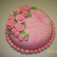 First Fondant Cake This is my first time using fondant. Made the MMF and marblized it. I was very happy with the marbling. I also made the Duff roses out of...