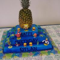 Spongebob Cake this is the cake i made for my sons 1st bday party it was huge 3 layers with a real pineapple on top!