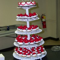 Cupcake Wedding Cake All BC icing. Each cupcake has an individual rose on them.