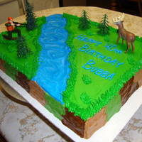Deer Hunter Cake !/2 sheet cake. BC icing with figurines