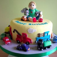 Boy With Toys   This cake is a wonderful theme for a young boy, with all the cars he loves.It is an 8in round cake done on a 12in board