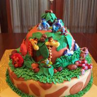 "Jungle Birthday This cake is for my daughters 4th birthday tomarrow. She LOVES giraffes so I had to do something with them in it. The cake is 12""..."