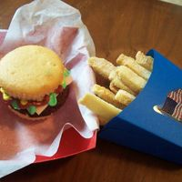 Cupcake Brownie Burger And Fries  White cupcake with a brownie for the burger . Buttercream fondant for cheese and red, green and yellow icing for the condements. French...