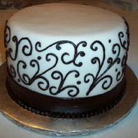 Scroll Work Bridal Shower  3 layer dark chocolate sour cream cake with vanilla cream cheese butter cream and vanilla fondant. I had lots of issues with this cake. It...