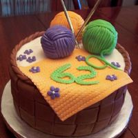 Kniting Basket Cake Orange cake with dark chocolate ganache filling and cream cheese butter cream icing covered in vanilla fonderific fondant (tinted brown)....