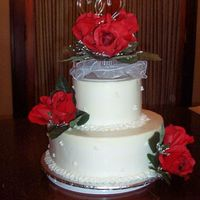 Round White Wedding Cake With Red Roses  This was only the 2nd wedding cake I have made. I tried the upside down icing method for the first time and I do like the crispness of the...