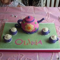 Tea Pot Cake white cake with MFF...tea pot made with ball pan covered in MFF and cups are cup cakes covered in MFF.