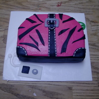 Zebra Print Purse a purse cake for my baby....fondant accents w/bc icing.