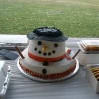 "Snowman This was for Christmas in July. 14"" yellow torted with strawberry filling, 2- 8"" (1 butter & 1 chocolate) cakes with..."