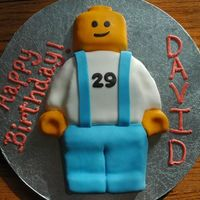 Lego Minifig For a LEGO-lovers birthday! Yellow cake, iced in buttercream and covered in fondant.