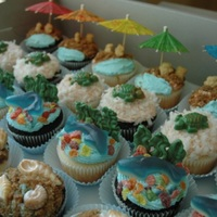 Beach Cupcakes 1 dozen chocolate and 1 dozen vanilla cupcakes iced with buttercream and decorated in assorted beach themes. Toppings include custom...