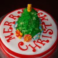 Christmas Cake - Christmas Tree Cake  I made this 1 layer cake with modelling fondant (fondant mixed with gum tragacanth) christmas tree and present accents. Thank you for...