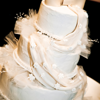 Ivory Wedding Cake Cream Cheese Pound Cake, BC icing, MMF bow and drape. Drape overlaid with tulle and RI flowers