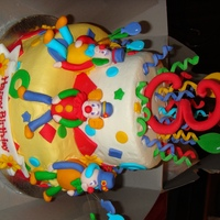 Clown Cake French Vanilla and Dark Chocolate Fudge cakes, BC icing with MMF accents. All decorations are edible.