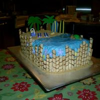 Luau Cake Buttercream with fondant accents, graham crackers for sand and a touch of piping gel for the water.