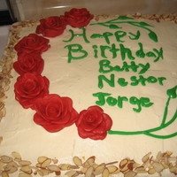 Red Roses  French Vanilla cake with strawberry and pineapple filling topped with whippping icing,and finally sprinkled with almonds. I made the rosese...