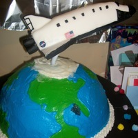 Space, Above And Beyond 40! Space shuttle is made of RCT covered with royal icing then BC then fondant with details piped in royal. The globe is a neopolitian cake,...