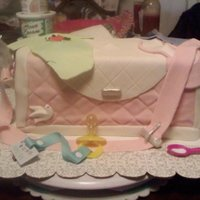 Diaper Bag This cake was made for my niece. Lemon cake with MMF. The pacifer, spoon and laces on the shoes are the only things not edible. My neice...