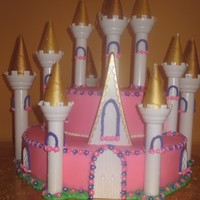 "Castle Cake I made this castle cake for a friend whose daughter who just turned 1yr old.Bottom cake is a 14"" devils food ake with buttercream..."