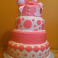 Pink Babyshower i made this cake for a friend of mine cousin for her baby shower. everything is edible except for the rattle on top.cakes are red velvet,...