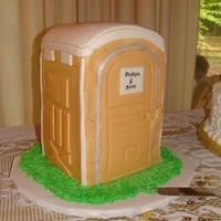 Porta-Potty All chocolate cake on inside, iced with BC icing fondant accents. This cake was the grooms cake for a 50th anniversary. The groom owns a...