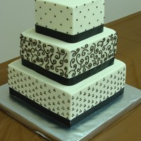 Natural Elegance Cream cheese pound cake with real butter BC icing and piped chocolate designs.