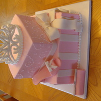 Fit For A Princess All BC icing with fondant accents. Shoe, Purse and bow are Fondant and the Tiara is Royal Icing.