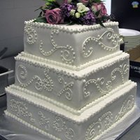 Scroll And Fresh Flowers Wedding Cake