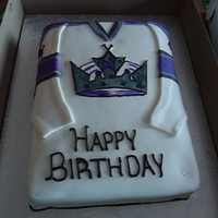 La Kings Jersey Cake Fondant covered 11x15 2 layer cake. Hand painted LA Kings logo.